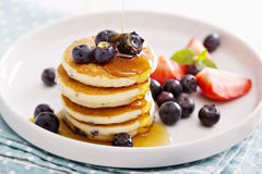 Stack of small pancakes with fresh berries Royalty Free Stock Image