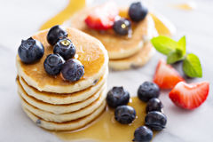 Stack of small pancakes with fresh berries Stock Image