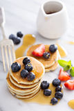 Stack of small pancakes with fresh berries Stock Photography