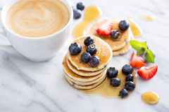 Stack of small pancakes with fresh berries Royalty Free Stock Photography