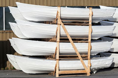 Stack of small white new packed boats stock photography