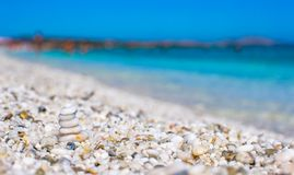 Stack of small white stones on tropical pebbles Royalty Free Stock Photos