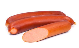 Stack of smoked sausages isolated on a white background.  Stock Images
