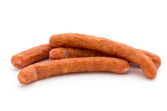 Stack of smoked sausages isolated on a white background. Royalty Free Stock Images