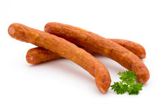 Stack of smoked sausages isolated on a white background. Stock Photography