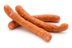 Stack of smoked sausages isolated on a white background. Royalty Free Stock Image