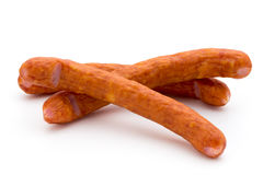 Stack of smoked sausages isolated on a white background. Stock Photos