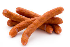Stack of smoked sausages isolated on a white background. Royalty Free Stock Photo
