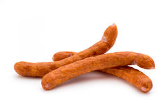 Stack of smoked sausages isolated on a white background. Stock Photo
