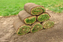 Stack of Sod Rolls. A Stack of Sod Rolls on the Dirt royalty free stock photography