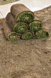 Stack of Sod Rolls. A Stack of Sod Rolls on the Dirt royalty free stock image