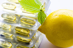 Stack of soft capsules and lemon Stock Image