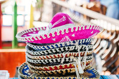 Stack of sombreros at a market in Mexico Stock Image