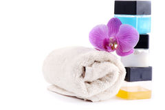Stack of spa accessories with flower and towel Royalty Free Stock Image