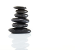 Stack of spa hot stones Royalty Free Stock Photo