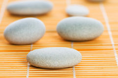 Stack of spa pebbles against background Royalty Free Stock Photos
