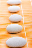 Stack of spa pebbles against  background Stock Image