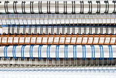 Stack of spiral paper notebooks with coil binding Royalty Free Stock Image