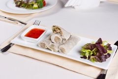 Stack of Spring Rolls with Sauce and Garnish Royalty Free Stock Photo