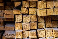 Stack square blocks timber building materials lumber end of the board close-up background light beige stock images