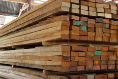 Stack of square wood planks for construction in warehouse stock photos