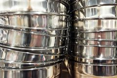 Stack of stainless steel pots cookware background royalty free stock photos