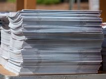 Stack of stapled periodicals sitting in a stack stock image