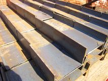 Stack of steel channels on a wooden pallet. Large stack of steel channels of large size on a wooden pallet stock photo