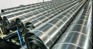 Stack of steel or metal pipes or round tubes as industrial background royalty free stock photo