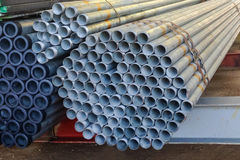 Stack of steel pipes bar - iron metal rail lines material. Stock Photos
