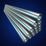 Stack of steel pipes. Stack of steel metal pipes. 3d render on blue. Business industry concept Royalty Free Stock Images