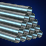 Stack of steel pipes. Stack of steel metal pipes. 3d render on blue. Business industry concept Royalty Free Stock Photos