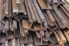 Stack of steel and rusty rail profiles. Rail profiles-cross sections Royalty Free Stock Photography