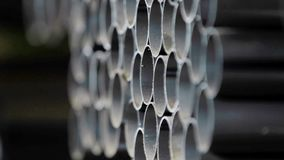Stack of steel tubes Industrial. Pipes on warehouse Rows of metal pipes on industrial warehouse at manufacture plant Stack of steel tubes Industrial background stock footage