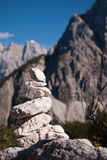 Stack stone with mountains background. Stack stone with not in focus background high Alp mountains Royalty Free Stock Photos