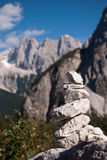 Stack stone with mountains background. Stack stone with not in focus background high Alp mountains Royalty Free Stock Photo