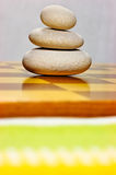 Stack of stones. On the chessboard. Shallow dof Royalty Free Stock Photos