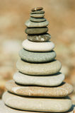 Stack of stones. Stack of flat stones on a gravel beach Royalty Free Stock Photos