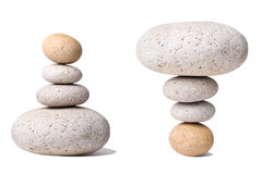 Stack of Stones with an antipode. A Stack of Stones  with an antipode on a white Background - a nice Zen-like Background Royalty Free Stock Photo
