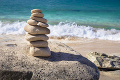 Stack of stones in balance at a beach Royalty Free Stock Image