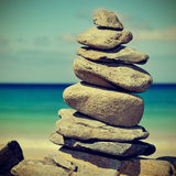 Stack of stones on a beach. Closeup of a stack of stones on a beach, with a retro effect Stock Photo