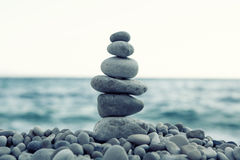 Stack of stones on the beach Stock Photos