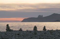 Stack of stones on beach, sea and sky at sunset. In Ibiza (Spain Royalty Free Stock Photo