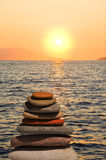 Stack of stones on beach at sunset Royalty Free Stock Photography