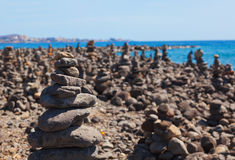 Stack of stones on beach Stock Images