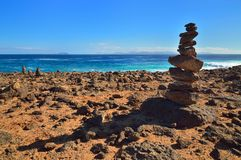 Stack of stones on cliff. Lanzarote, Canary Islands. Stack of st Royalty Free Stock Photos