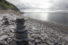 Stack of stones on fjord background royalty free stock images