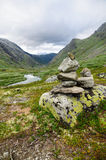 Stack of stones in front of valley Royalty Free Stock Image