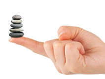 Stack of stones in hand Royalty Free Stock Photography