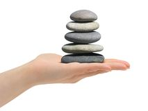 Stack of stones in hand Royalty Free Stock Photo